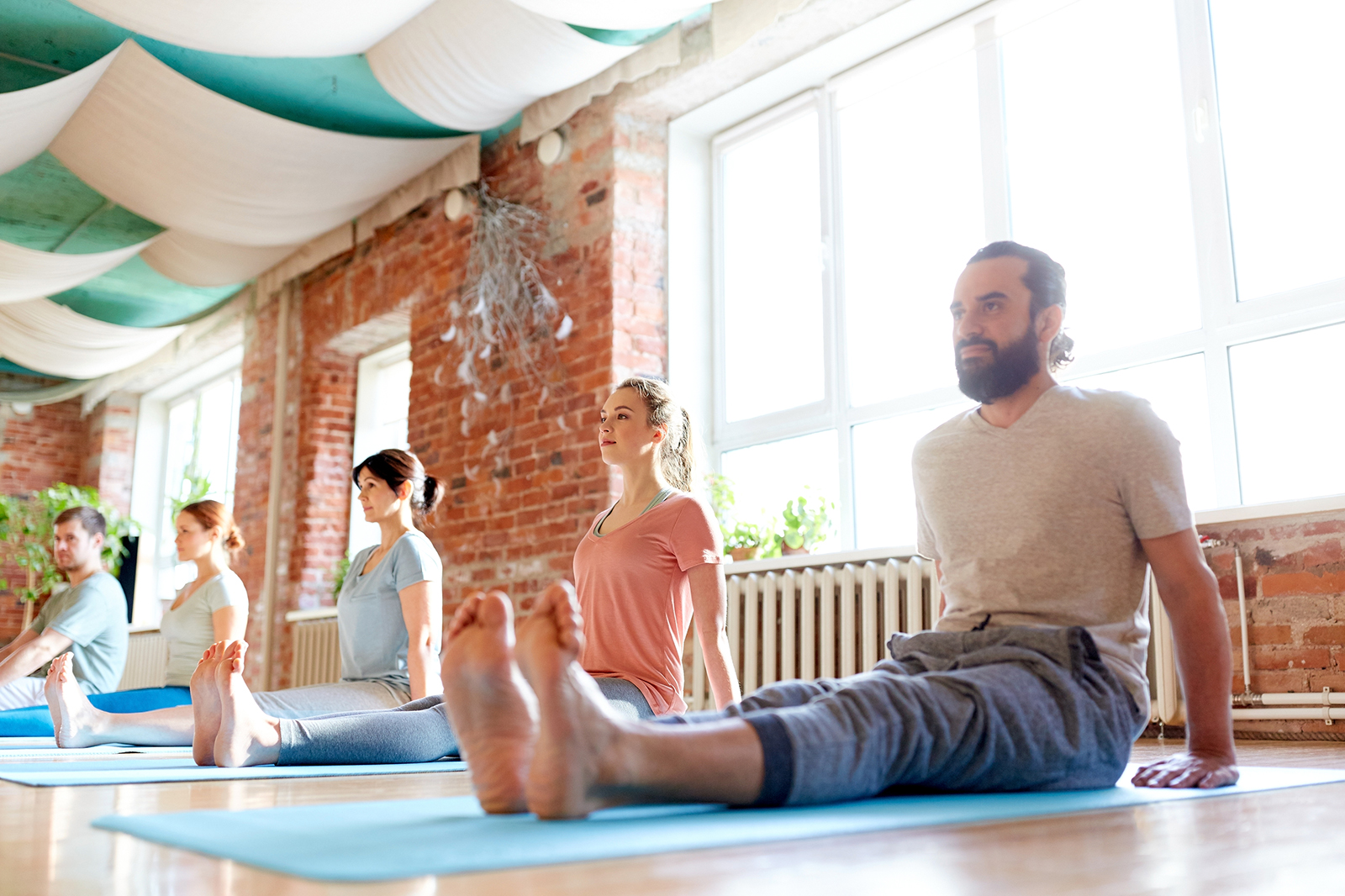Group Doing Yoga | Health, Happiness, and The Many Other Benefits of Yoga