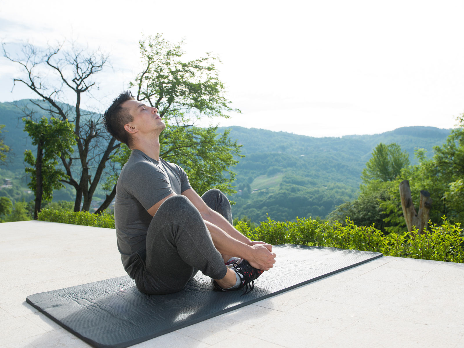 Man Doing Yoga Outdoor | 17 Most Popular Types Of Yoga: A Simple Breakdown