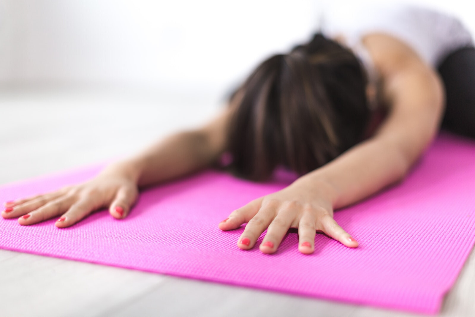 Woman Doing Yoga | The 7 Real Benefits Of Hot Yoga