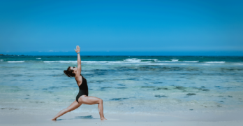 Woman Doing Yoga At The Beach | 10 Basic Yoga Poses For Beginners That You Can Start Today