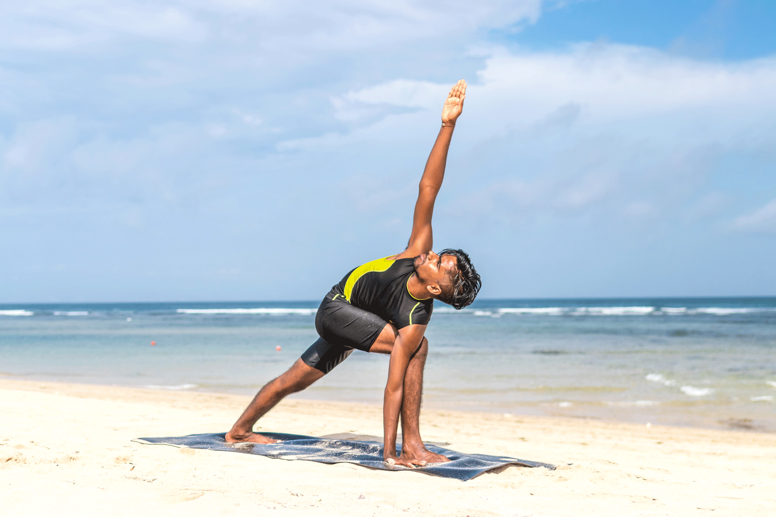 Man Doing Yoga At The Beach | 8 Surprising But Important Benefits Of Yoga For Men