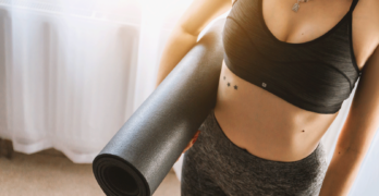 Woman With Yoga Mat | How To Pick The Right Yoga Studio For You