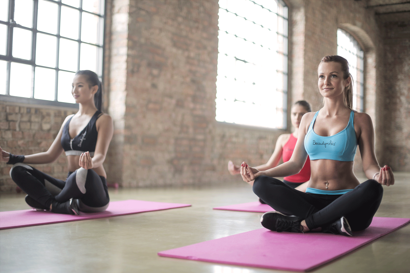Women Doing Yoga | How To Pick The Right Yoga Studio For You