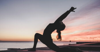 Woman Doing Yoga Sunset | The 3 Key Differences Between Vinyasa & Hatha Yoga