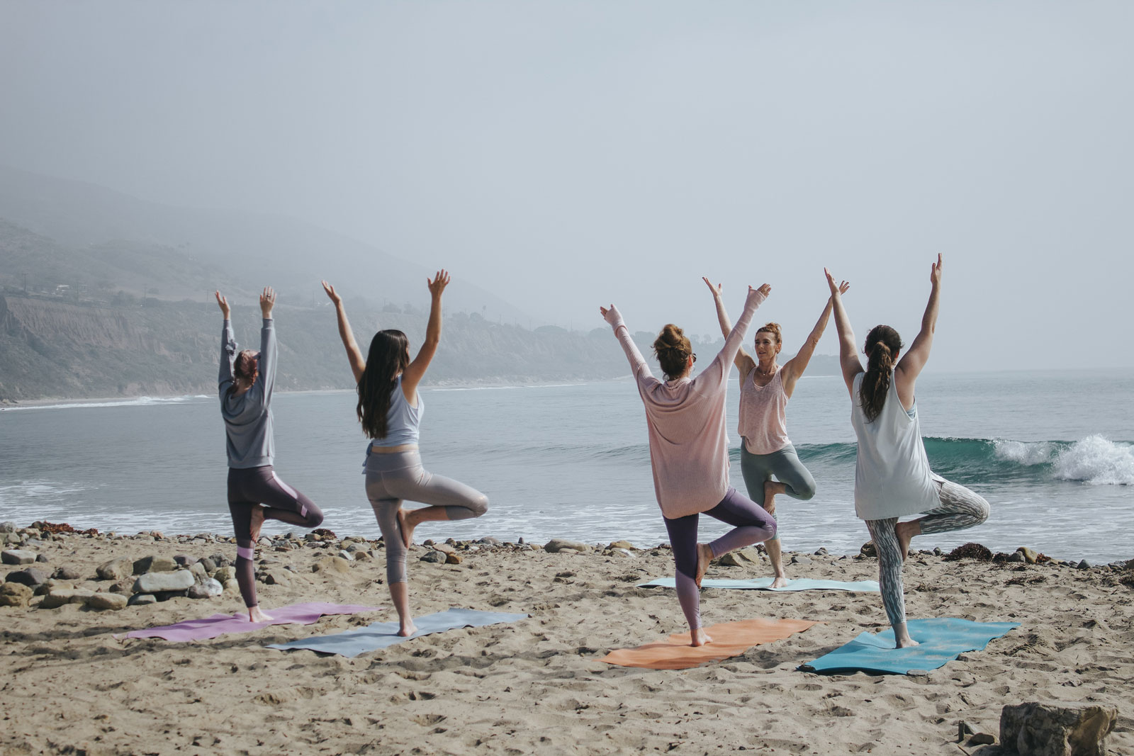 Women Doing Yoga at the Beach | The 3 Key Differences Between Vinyasa & Hatha Yoga