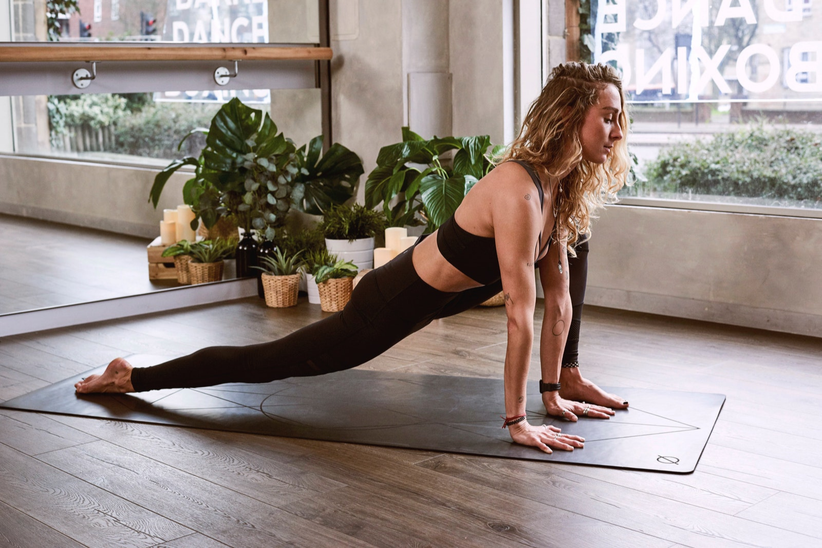 Woman Doing Yoga | Your First Yoga Class? Here Are 9 Tips To Help You Be Ready