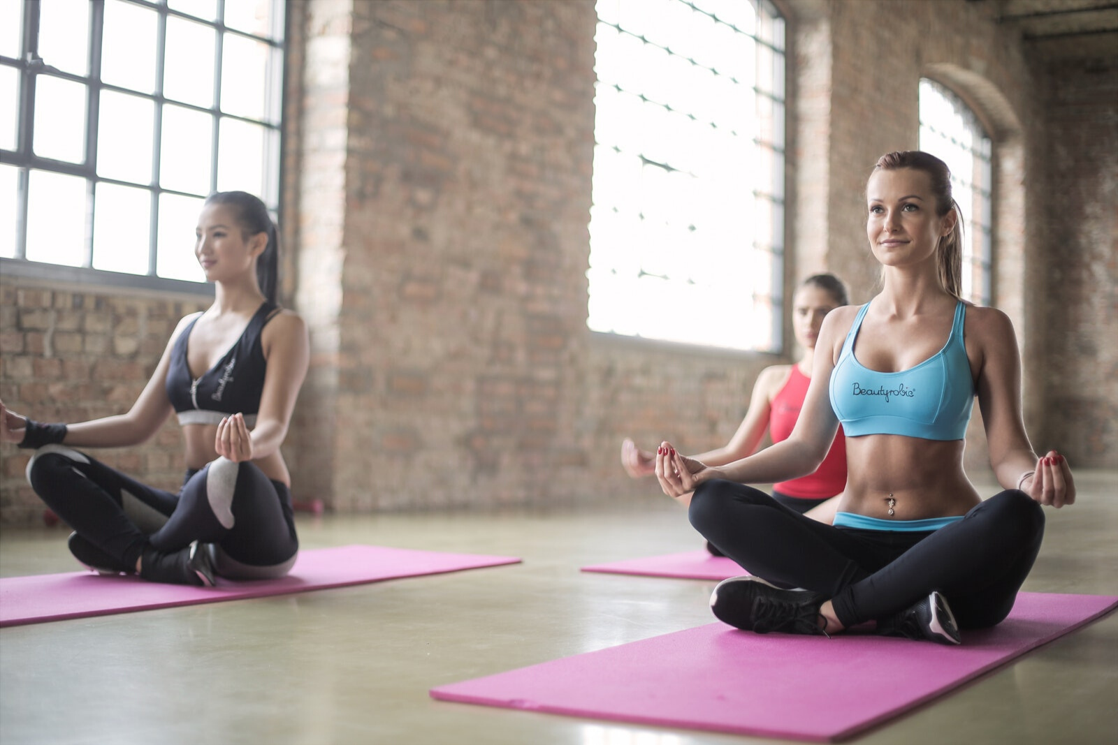 Women Doing Yoga | Your First Yoga Class? Here Are 9 Tips To Help You Be Ready