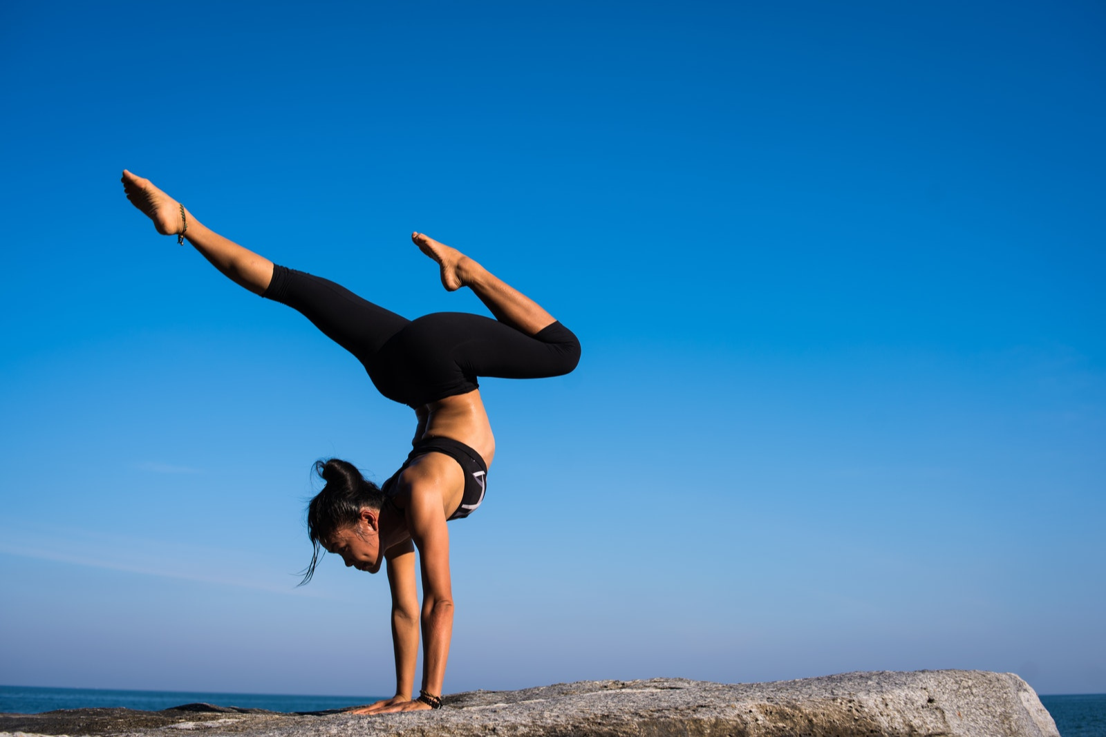 Woman Doing Yoga | 8 Morning Yoga Benefits To Help Jumpstart Your Day